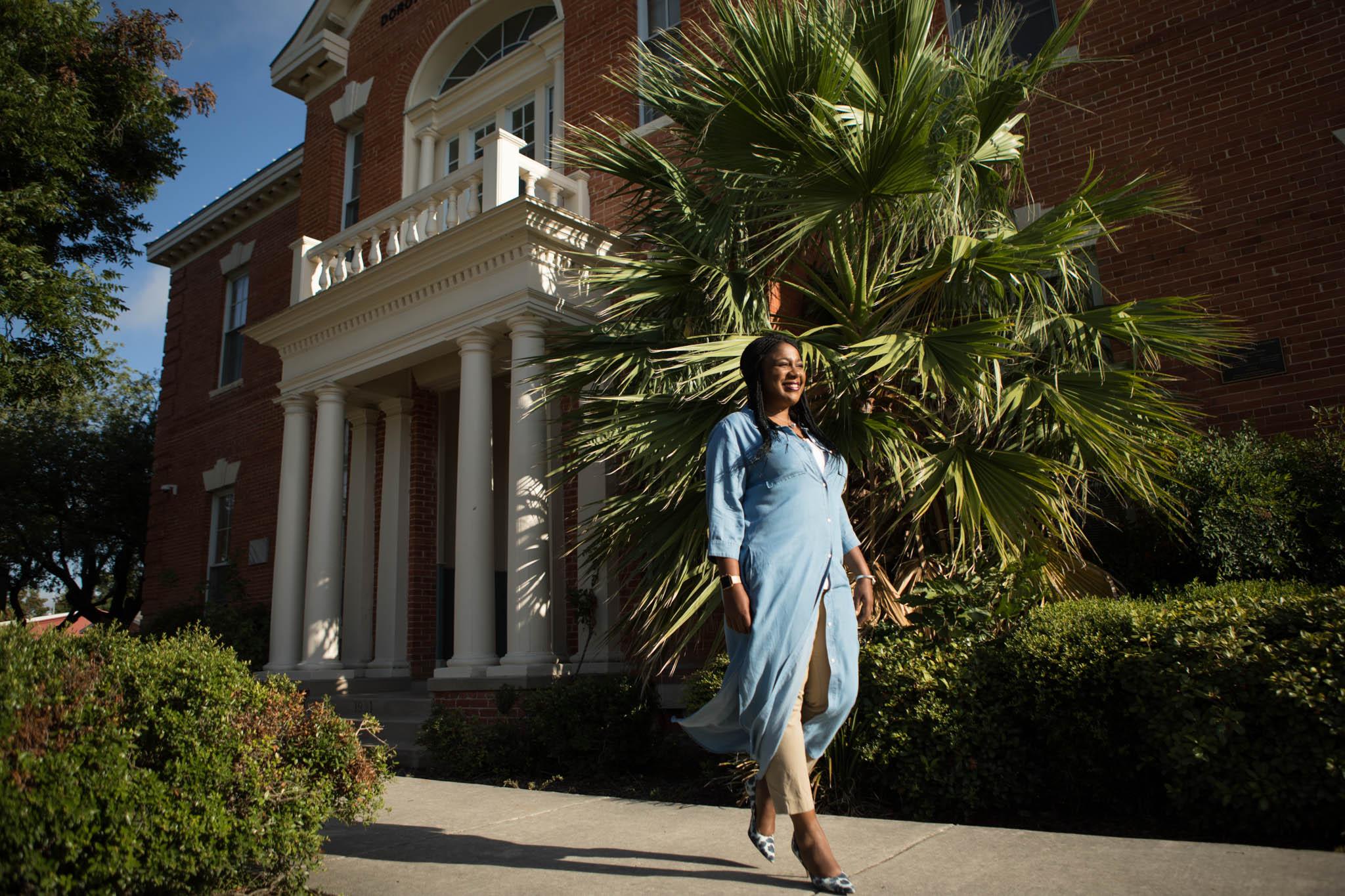 SAISD Chief of Staff Tiffany Grant walks outside of the new Pickett Parent Center.