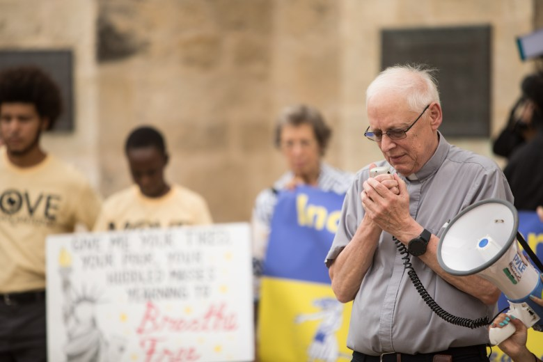 Col. Fr. Joseph Wagner says a prayer at the vigil for migrant deaths at San Fernando Cathedral.