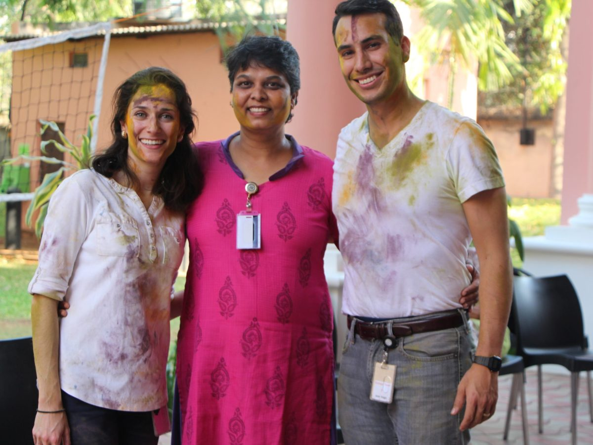 Maridela Ortiz (left) and Jose Vega with unidentified consulate employee celebrate the Indian holiday Holi on the consulate grounds at Paigah Palace