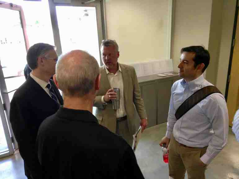 210 Development Group President Michael Wibracht (center) talks with associates on the Mission Concepción apartment project following the Historic and Design Review Commission meeting on Wednesday, July 19, 2017. Photo by Edmond Ortiz
