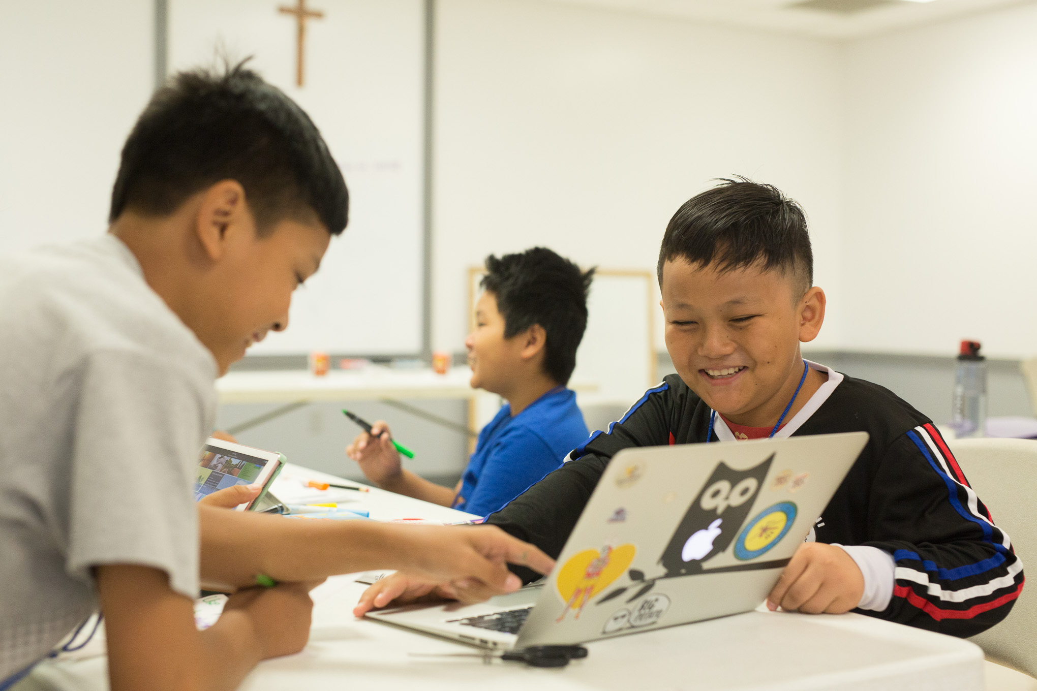 Ti, 10, works on interactive class work on the topic of pollution.