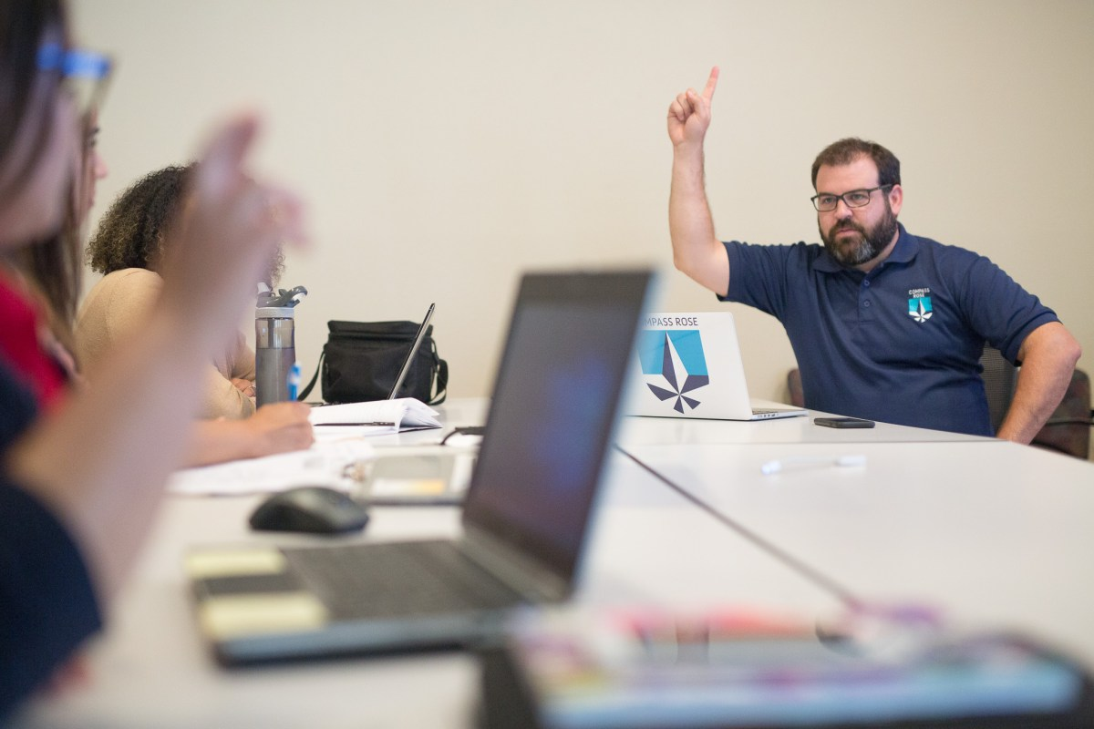 Compass Rose School Leader Paul Morrissey works on developing hand signals that students will be using at the new charter.