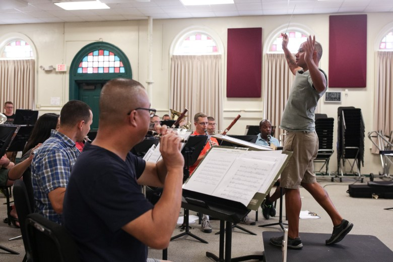 Sgt. Joe Samuel conducts the 323D Army Band through a selection during rehearsal.