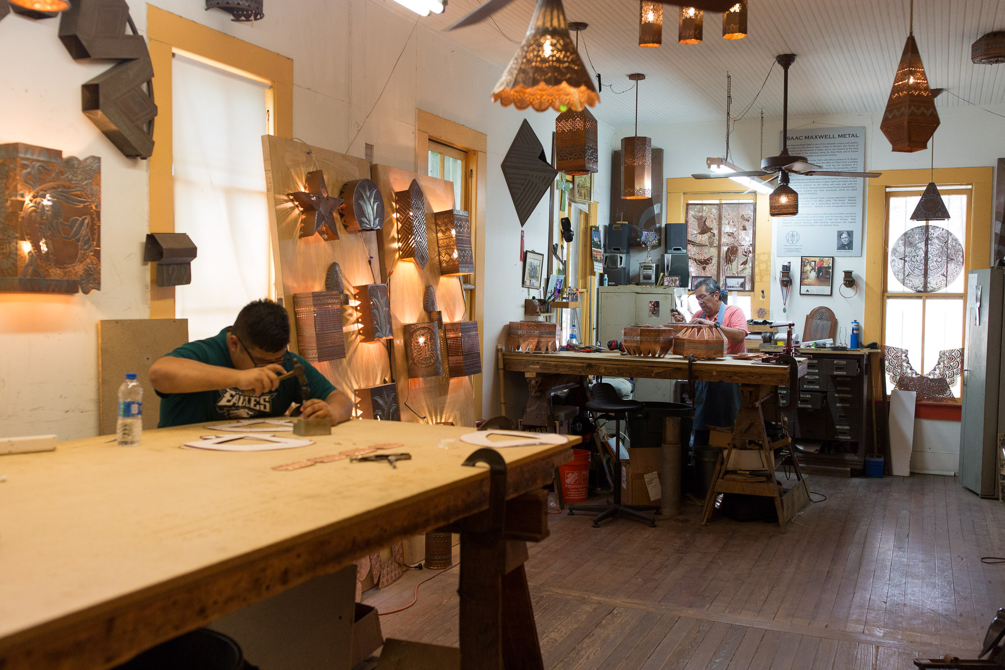 Gregorio Rebollar and his grandson Abel Gonzales work in a family craft that has been in the works for 40 years.