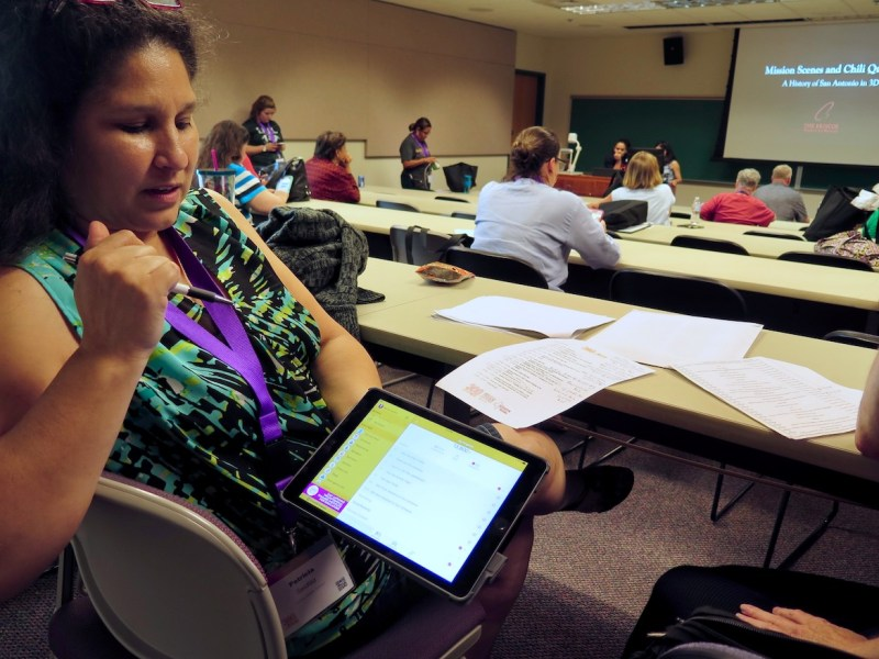 Zachry Middle School teacher Patricia Seidlitz demonstrates how the Teacher Ambassador mobile app works to engage and connect teachers throughout the city.