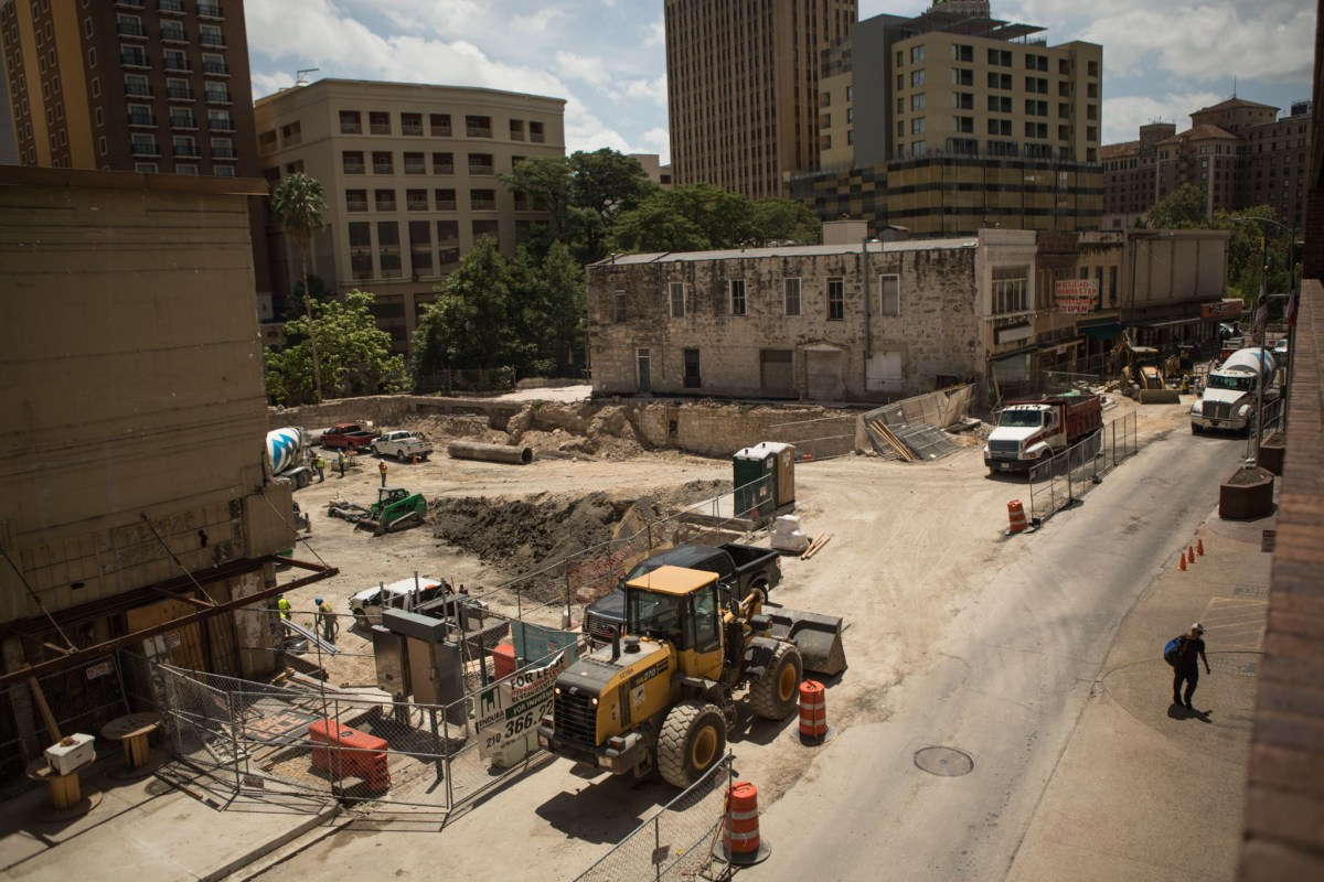 Construction crews work on an eight-story hotel that will replaced the demolished Solo Serve building.