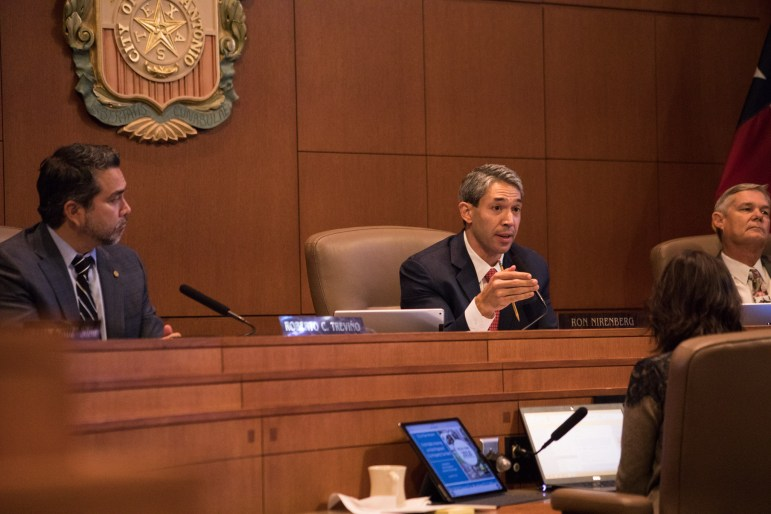 Mayor Ron Nirenberg (Center) calms down the audience and asks for the cooperation of the audience at citizens to be heard at Council Chambers regarding the removal of the Confederate monument in Travis Park.