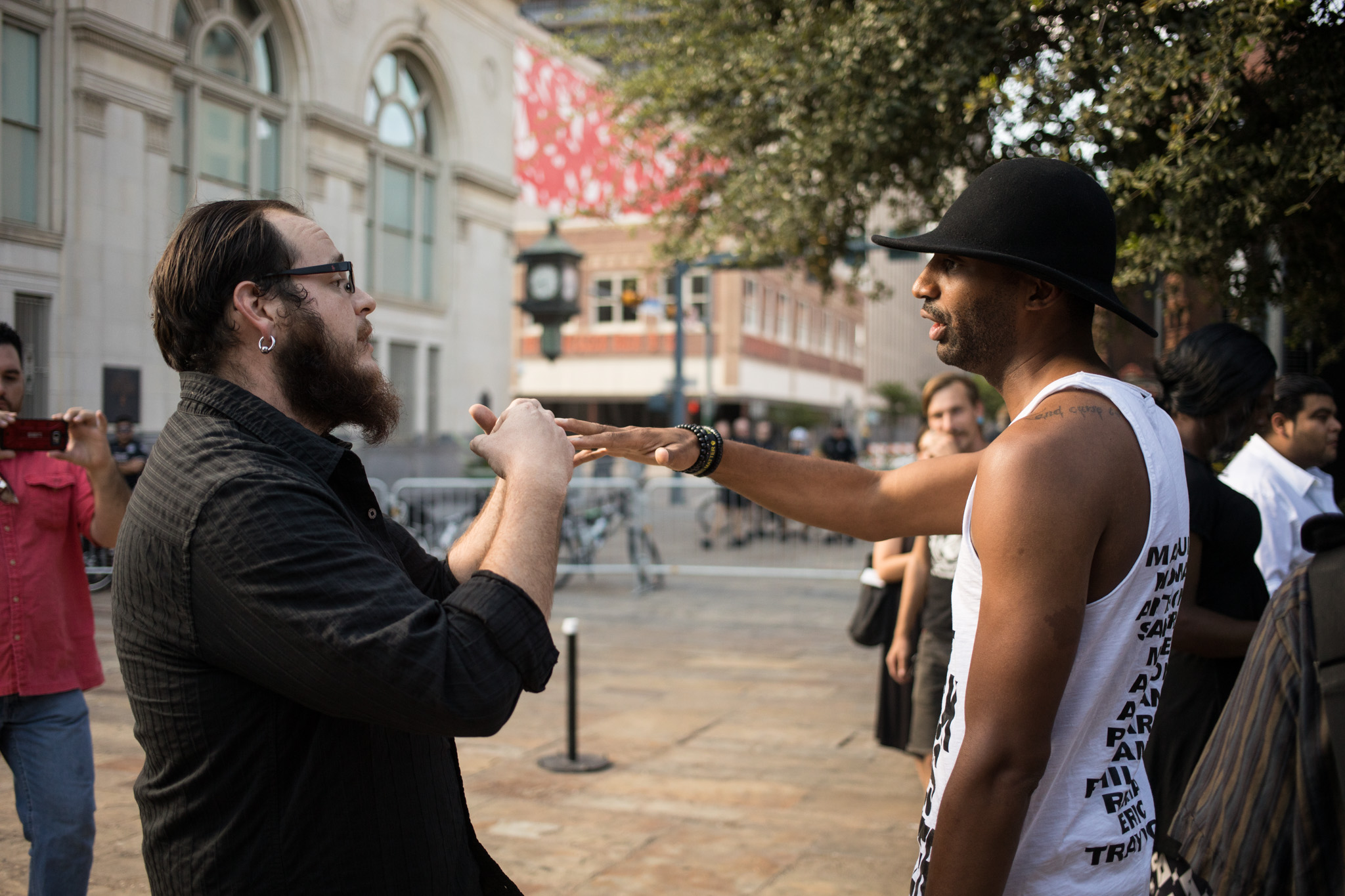 (From left) Paul Gescheidle and Activist Mike Lowe exchange heated words before entering citizens to be heard at Council Chambers regarding the removal of the Confederate monument in Travis Park.