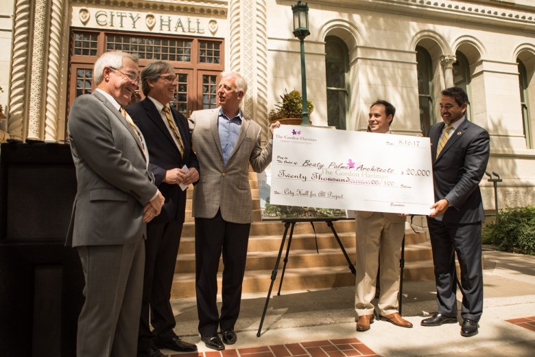 Beaty Palmer Architects Principals (from left) Michael Beaty and Terry Palmer accept a large check from (from left) Gordon Hartman Family Foundation Founder Gordon Hartman, AIA San Antonio Chapter President Adam Reed, and Councilman Roberto Treviño (D1) after being announced the winner of the City Hall For All Design Competition.