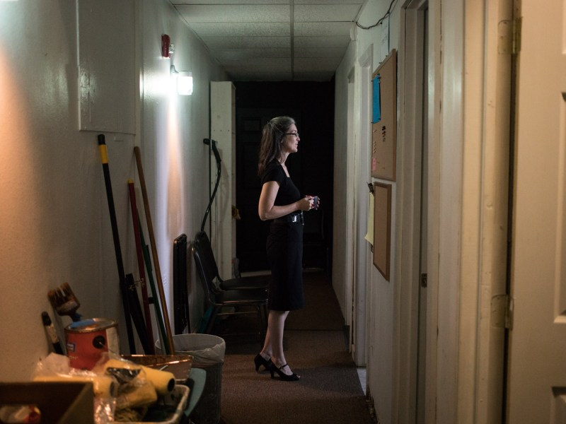(From left) The Classic Theatre of San Antonio Executive Director Kelly Hilliard Roush peeks into a room backstage.