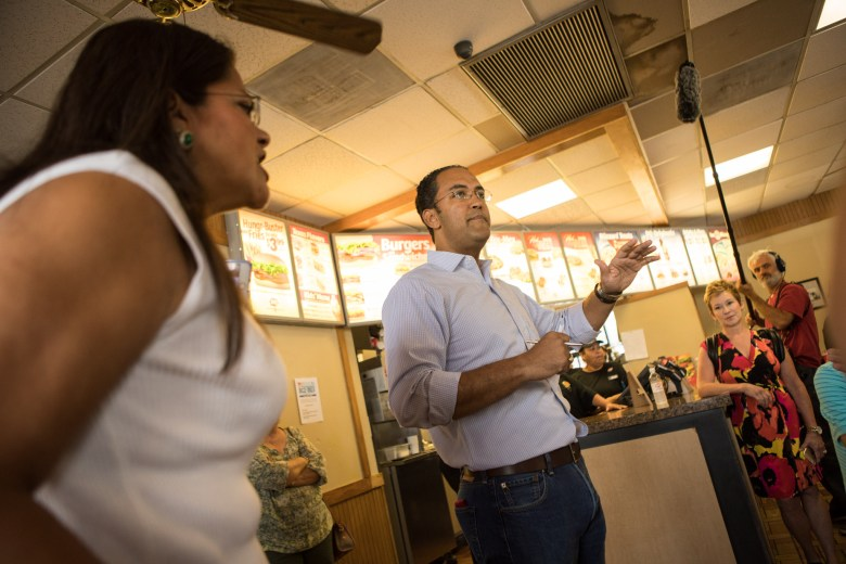 Rosey Abuabara (left) interjects her opinion during Congressman Will Hurd's (R-Texas) responses to questions of the crowd at a Diary Queen in Devine, Texas, at a stop along his Third Annual Town Hall Series DC2DQ.