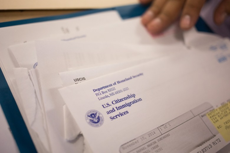 Diego Mancha Dominguez sorts through his past DACA paperwork received from U.S. Citizenship and Immigration Services.