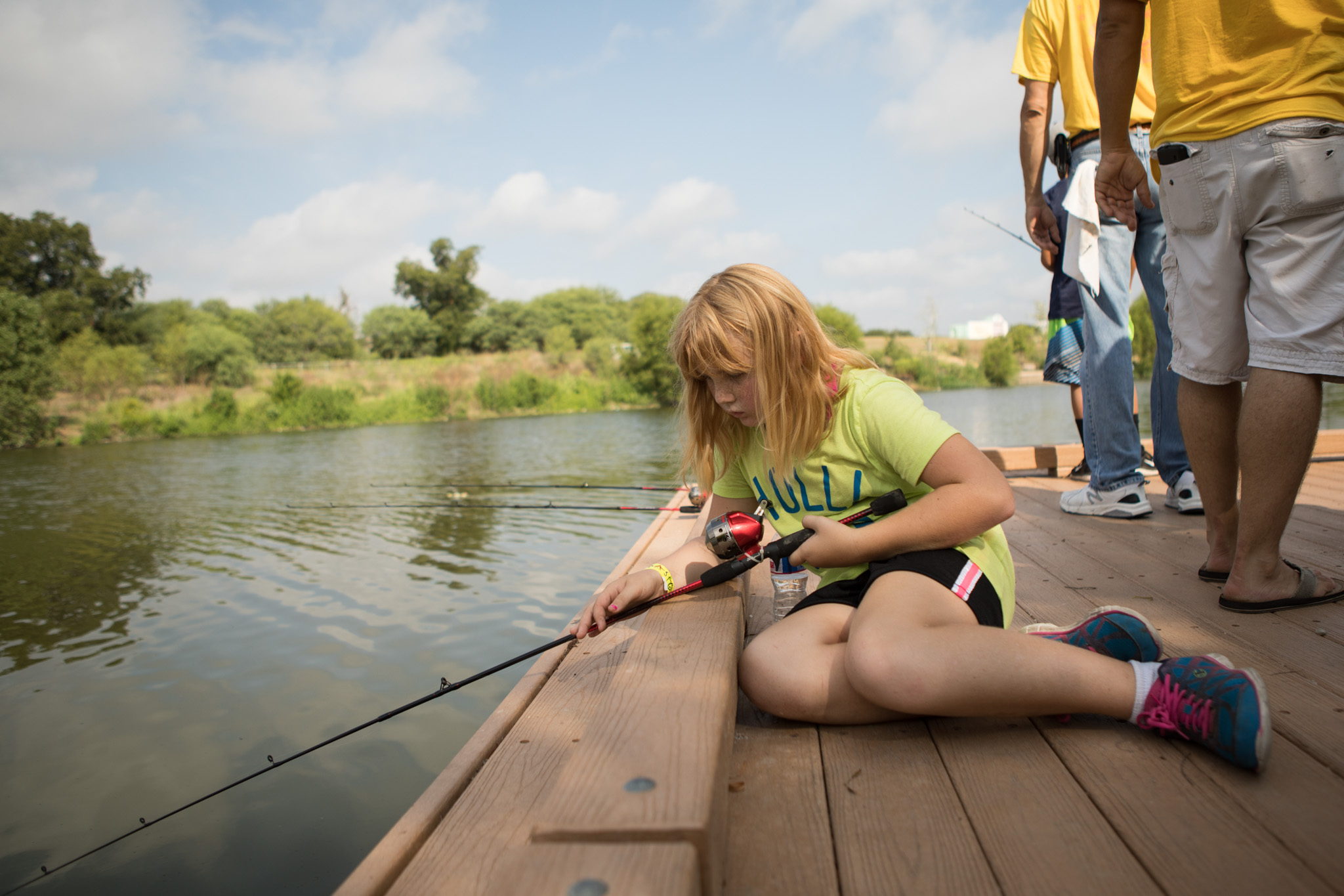 Harley, 10, watches for fish at Family, Fishing and Friends at Acequia Park.
