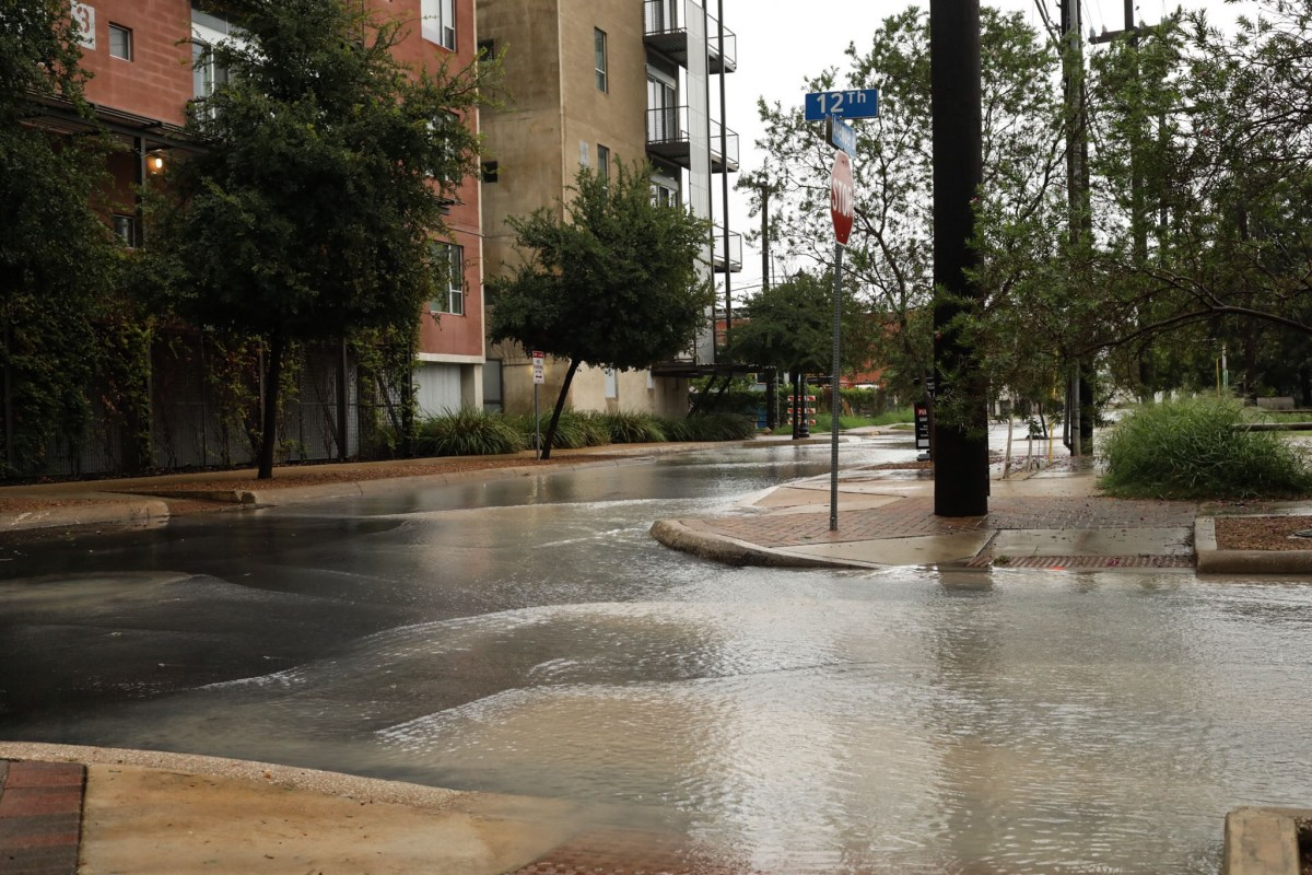 Water floods the intersection of Ave. B and 12th St. during Tropical Storm Harvey.