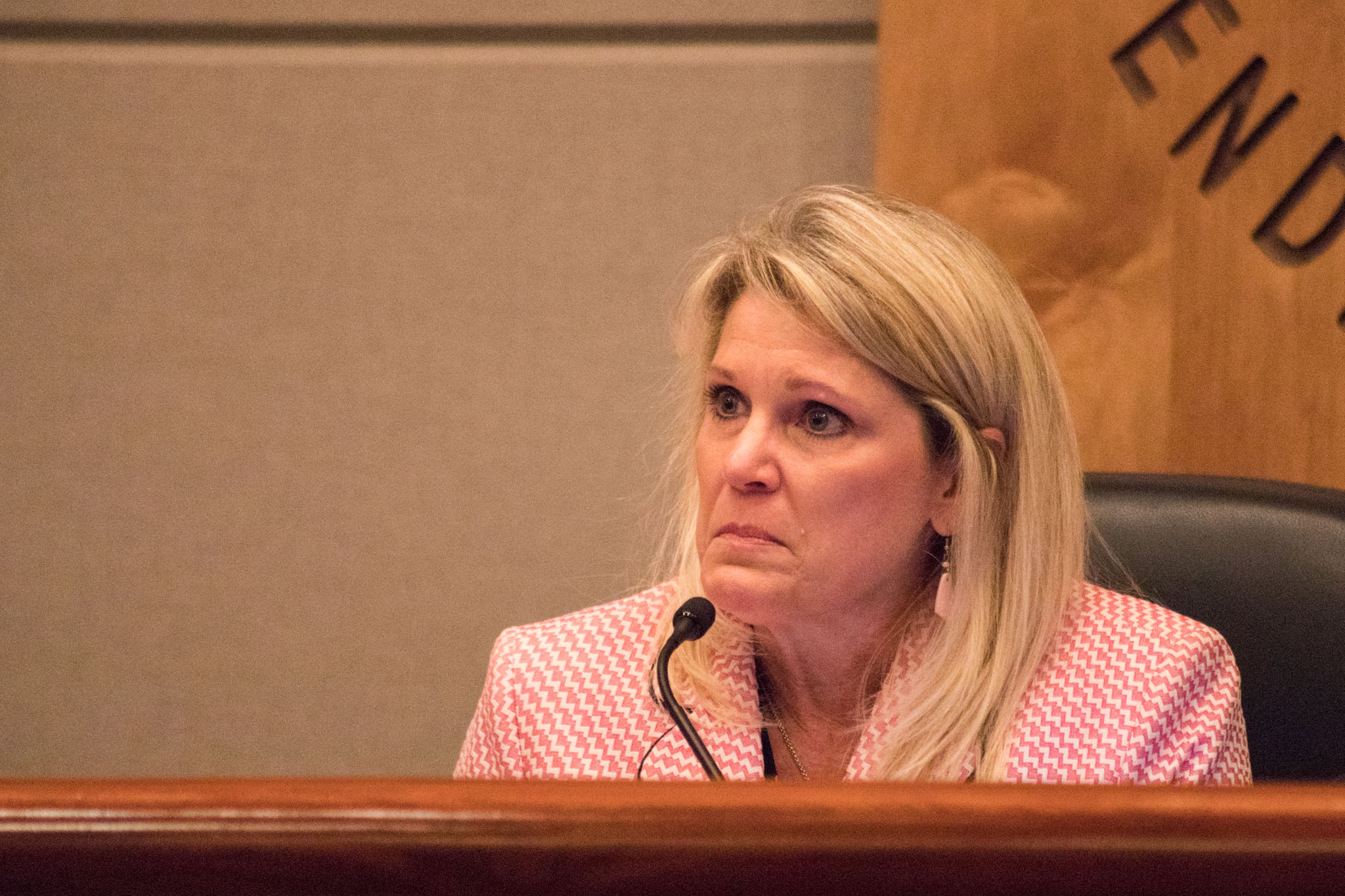 NEISD board President Shannon Grona tears up while talking about the tragedy in Houston.