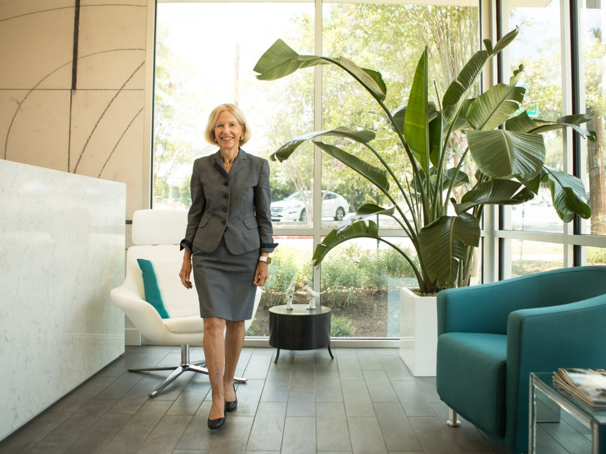 Phyllis Browning Company CEO Phyllis Browning walks in the entryway of her new office building.