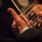 Harry Ufland holds his Lifetime Achievement Award in the audience of the San Antonio Film Festival awards ceremony.