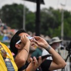 Attendees look up in awe at the beginnings of the total solar eclipse.