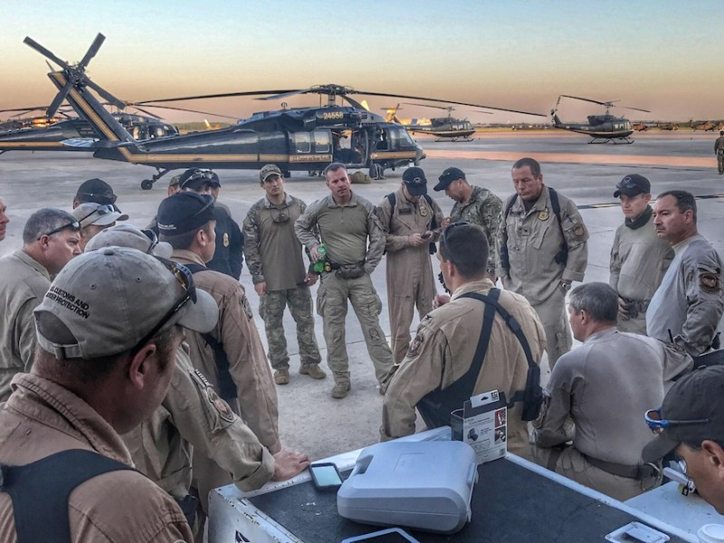 Customs and border protection officials meet on the Port San Antonio flight line prior to hurricane search and rescue missions.