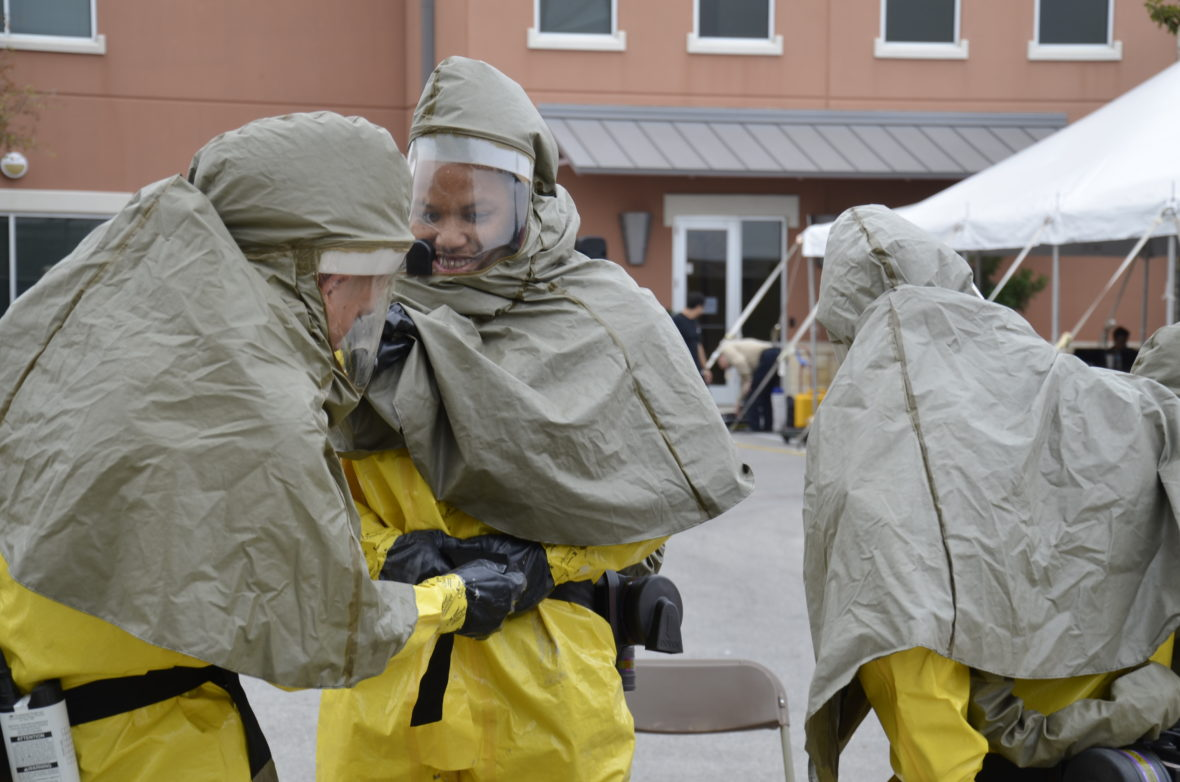 A team of first responders practices donning PPE during a training exercise at the South Texas Regional Advisory Council (STRAC). The STRAC works with the task force to assure first responders have up to date information.