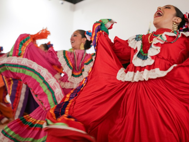 Members from the Guadalupe Dance Company perform at Plaza De Armas following the announcement.