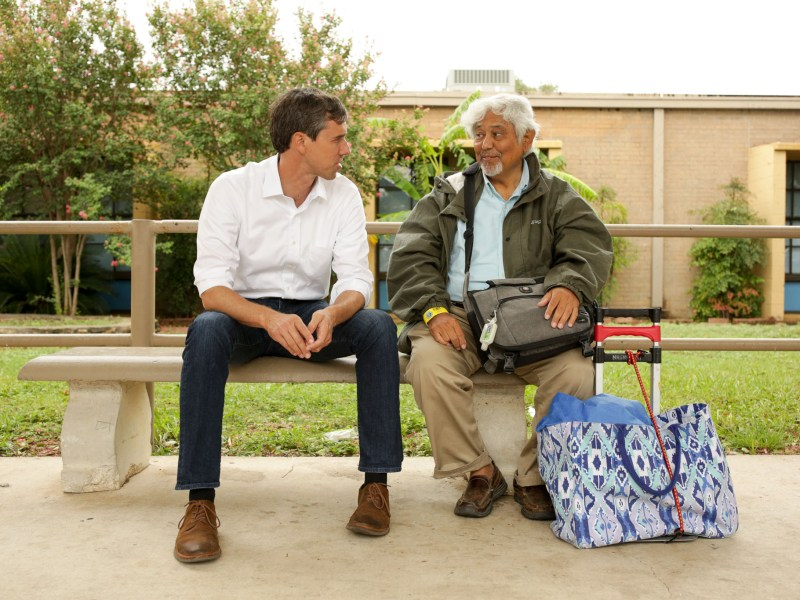 U.S. Representative Beto O'Rourke (D-TX) speaks with an evacuee of Corpus Christi.