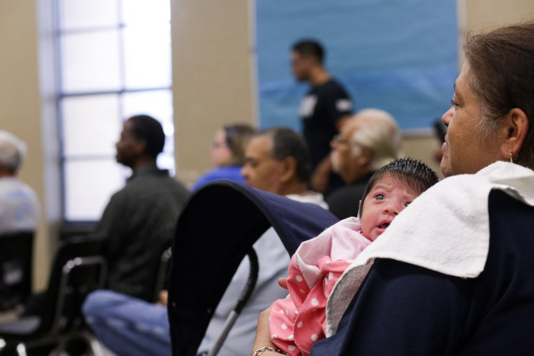 An infant child was among the evacuees at Kazen Middle School.