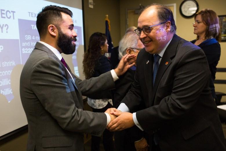 San Antonio Hispanic Chamber of Commerce President Ramiro Cavazos shakes hands with LGBT Chamber of Commerce President David Solis.