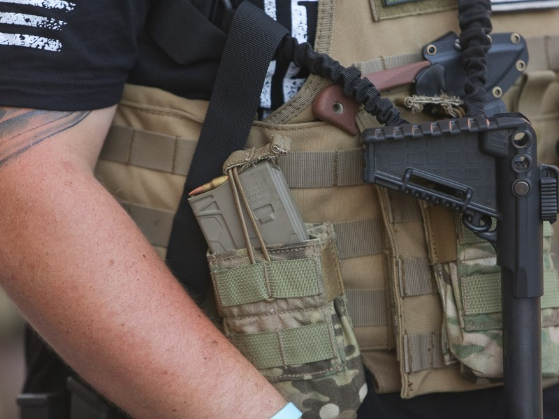 Loaded magazines and kevlar vests are worn by members of the TITFF (This is Texas Freedom Force).