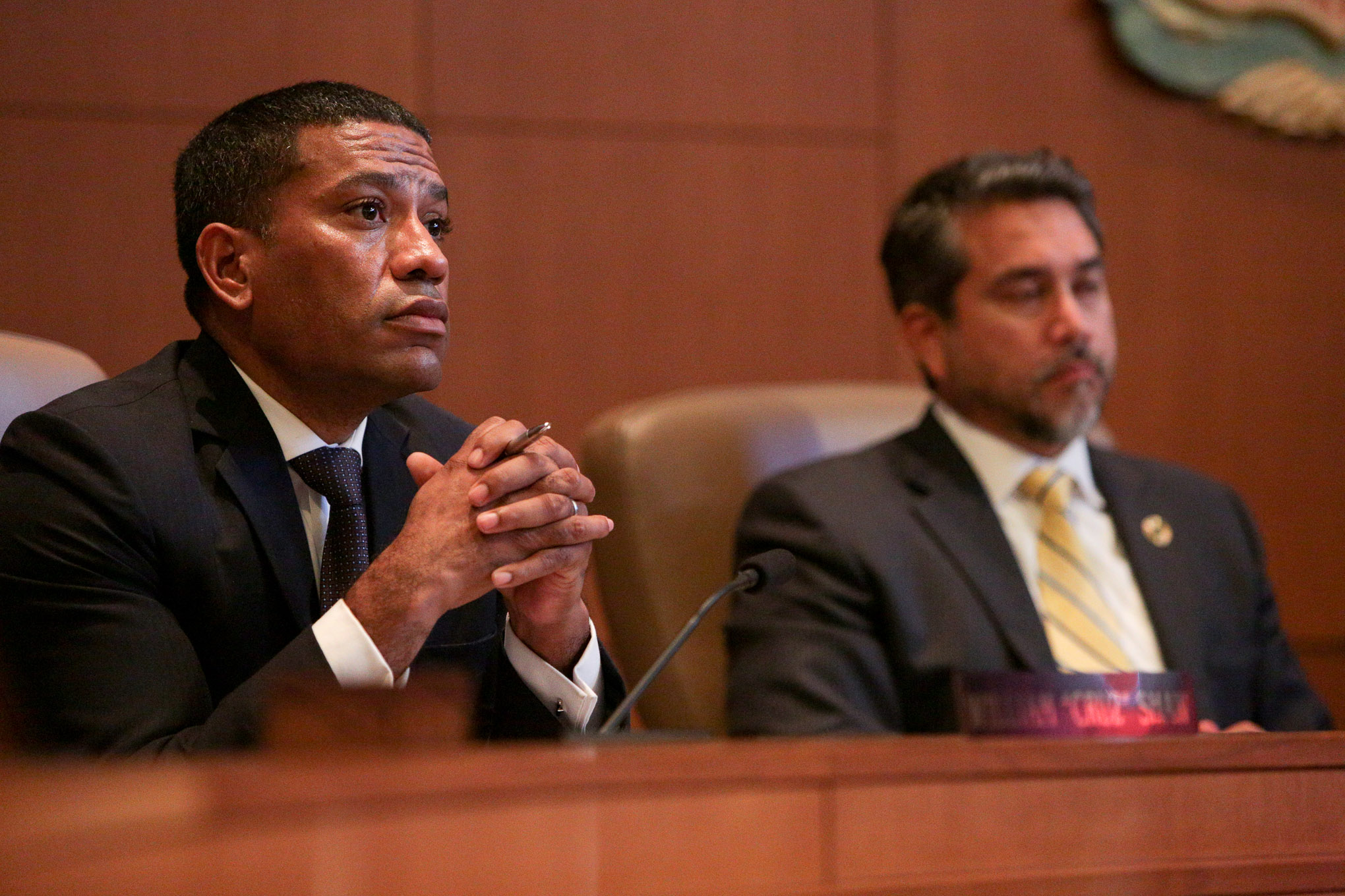 Councilman William 'Cruz' Shaw (D2) and Councilman Roberto Treviño (D1) consider a citizen's comments in opposition to the removal of a Confederate statue in Travis Park.