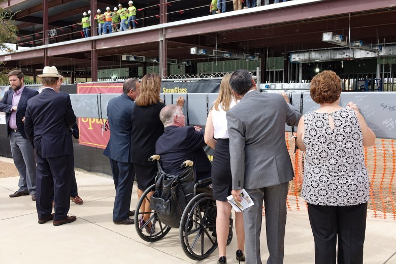 Texas A&M San Antonio faculty and staff along with elected officials sign support beams for the new building.