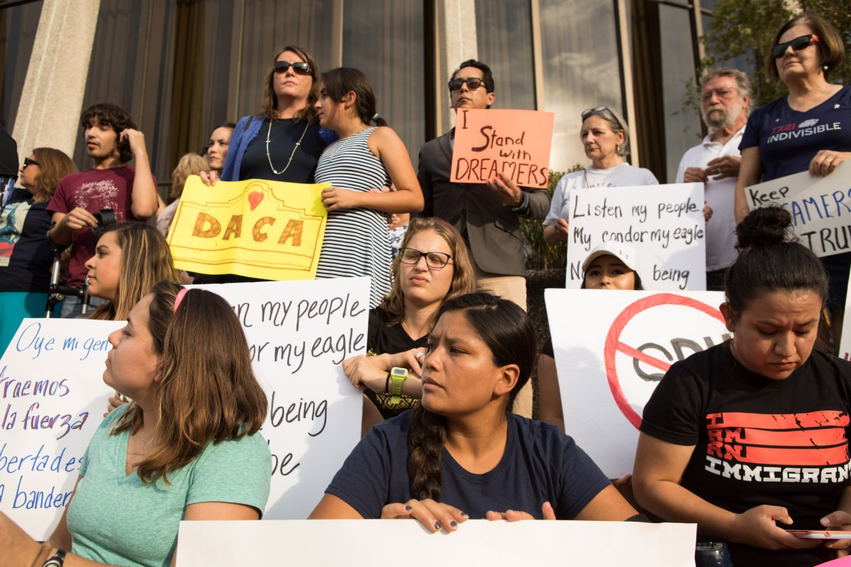 Hundreds of people gather in front of the John H. Wood Federal Courthouse to protest the Trump administration's decision to end DACA.