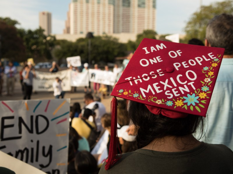 A woman wears her graduation cap to support of the Deferred Action for Childhood Arrivals (DACA) program.