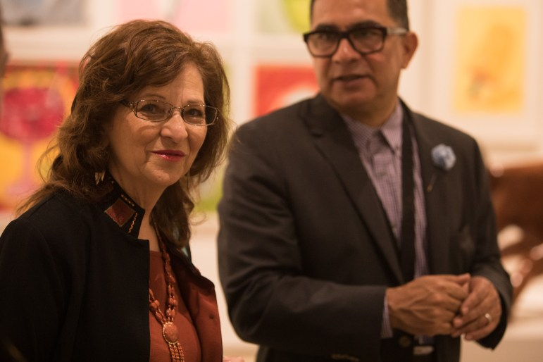 (From left) Distinction in the Arts Literary Arts Honoree Carmen Tafolla and Sebastian Guajardo socialize before the Third Annual Distinction in the Arts honoree announcement at the Centro de Artes Gallery.