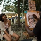 Party Pros Artist Jaime Alexander (right) draws a caricature of Katarina Romero at Jazz'SALive 2017.
