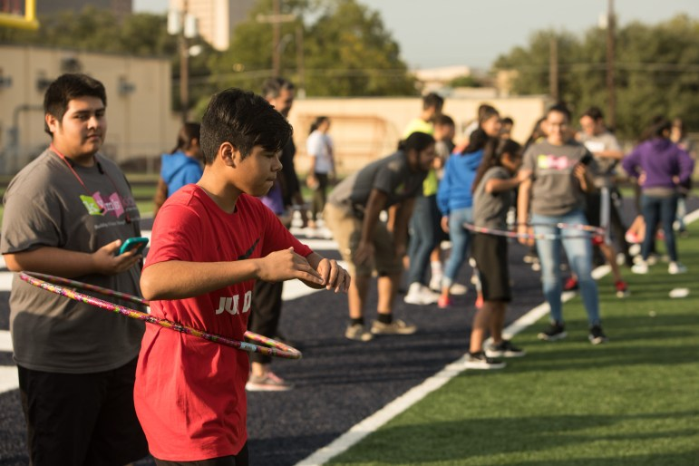 Miguel Campos, 13, completes the hoola hoop portion of an exercise obstacle course at the Forward in Fitness program kickoff at Central Catholic High School.