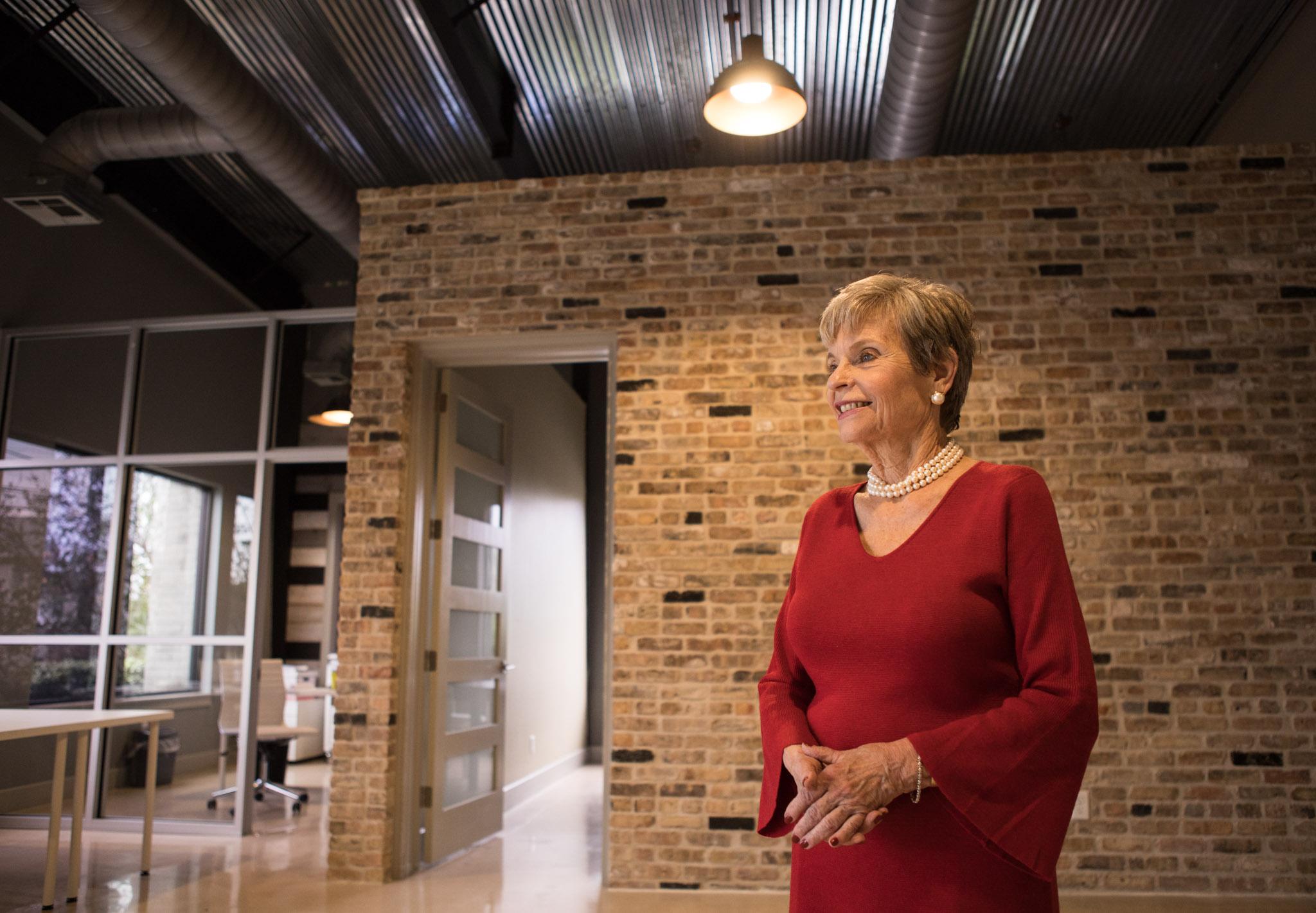 Biomedical Development Corporation Founder Phyllis Siegel walks through her office on East Dewey Place.