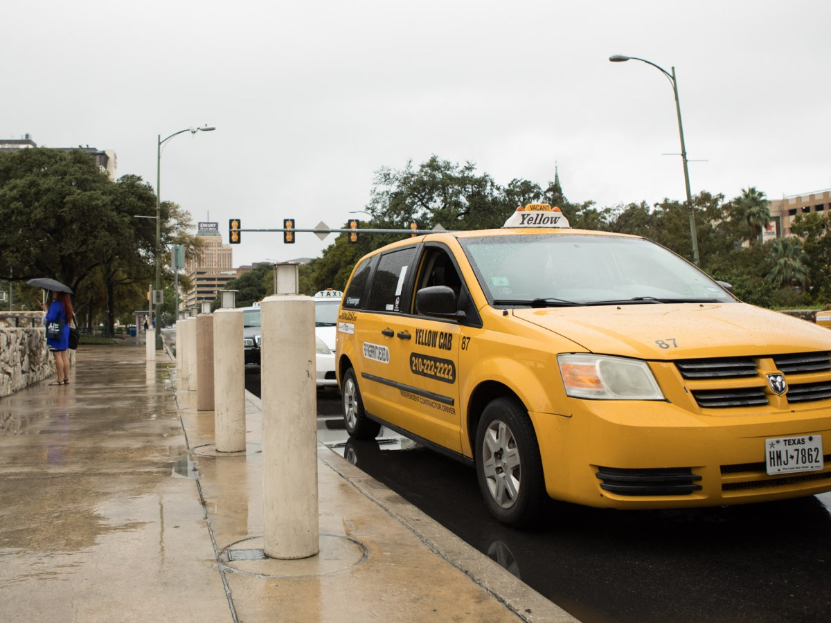 A taxi waits for customers outside of the Henry B. Gonzalez Convention Center.