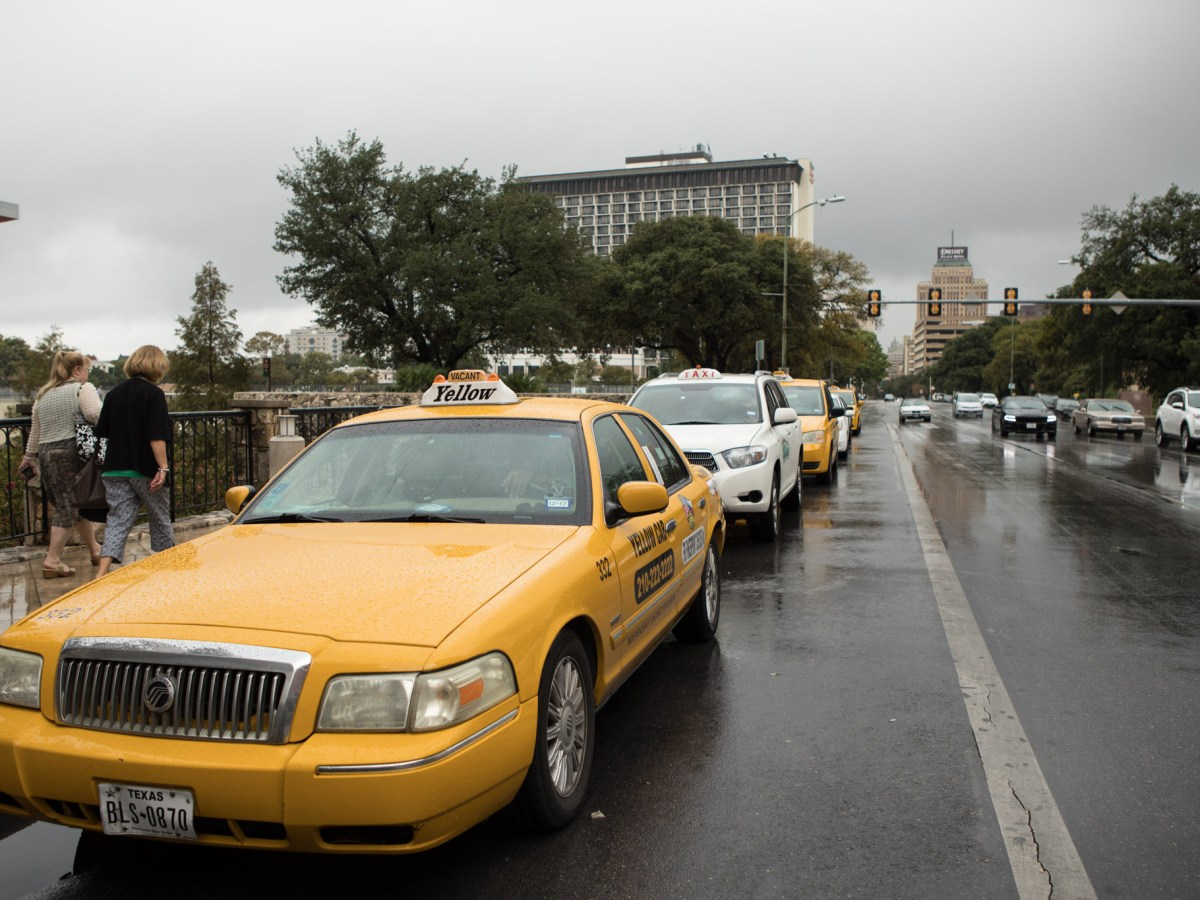 A line of taxis forms outside of the Henry B. Gonzalez Convention Center.
