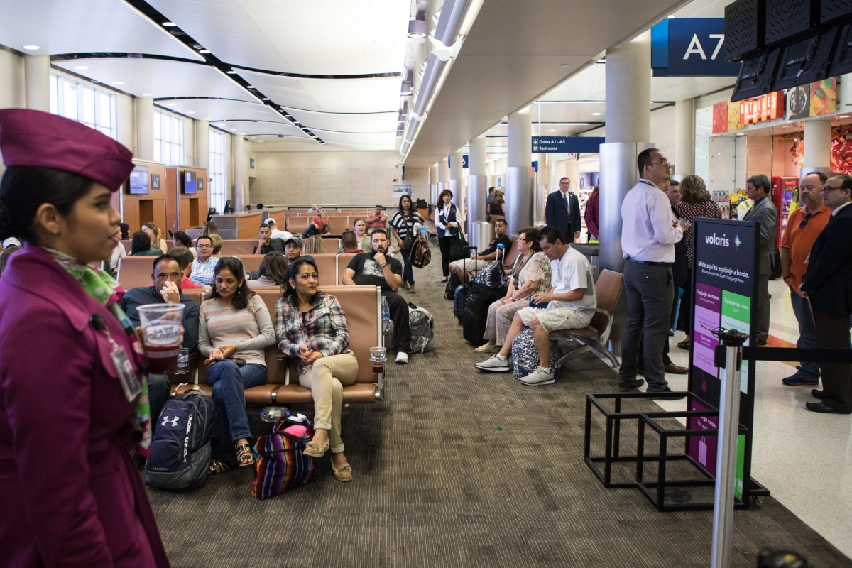 Passengers relax before boarding the first Volaris direct flight from San Antonio to Mexico City.
