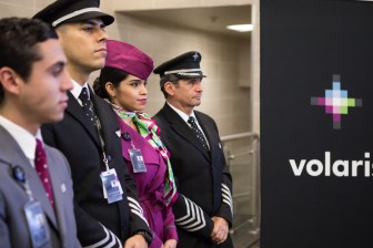 The Volaris flight crew aids attends the press conference for the first Volaris direct flight from San Antonio to Mexico City.