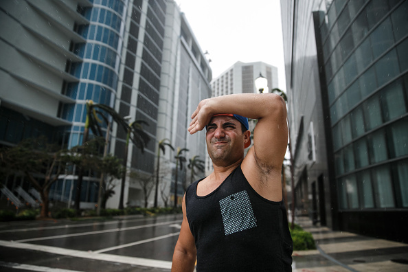 A man makes an effort to move forward against heavy wind conditions as Hurricane Irma brings wind and rain to downtown Miami, Florida.