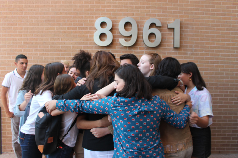 A group of students gathered around NEISD Board member Sandi Wolff after the vote to remove Robert E. Lee's name from their school.