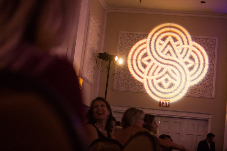 The Centro logo is projected on the walls of the Sheraton Gunter Hotel banquet hall for the Centropolitan Awards.