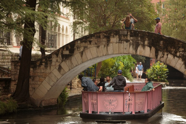 The newly updated San Antonio River Barges transport passengers through downtown San Antonio.