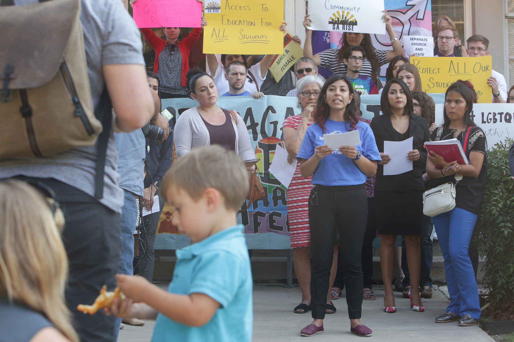 SAISD teacher Alejandra Lopez gives a statement during a press conference prior to the meeting.