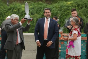 San Antonio River Authority Board Secretary Hector Morales (left) holds up the Thiess International Riverprize as Councilman Roberto Treviño (D1) looks on.