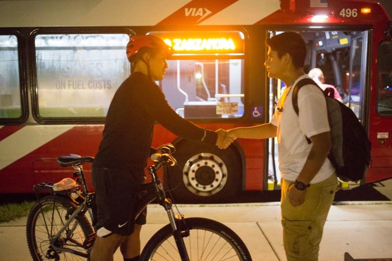Councilman Rey Saldaña (D4) greets 13 year old student David Borrego before he commutes to school using VIA.