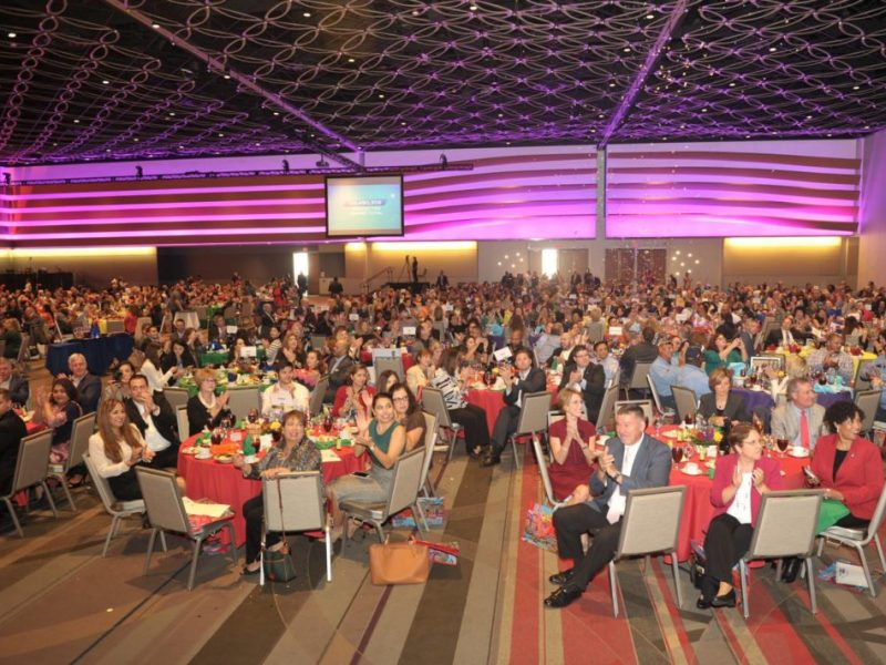A large crowd cheers in support of the Pacesetter Campaign result announcement at the Heart of the Community KickOff Luncheon at the Henry B. Gonzalez Convention Center.