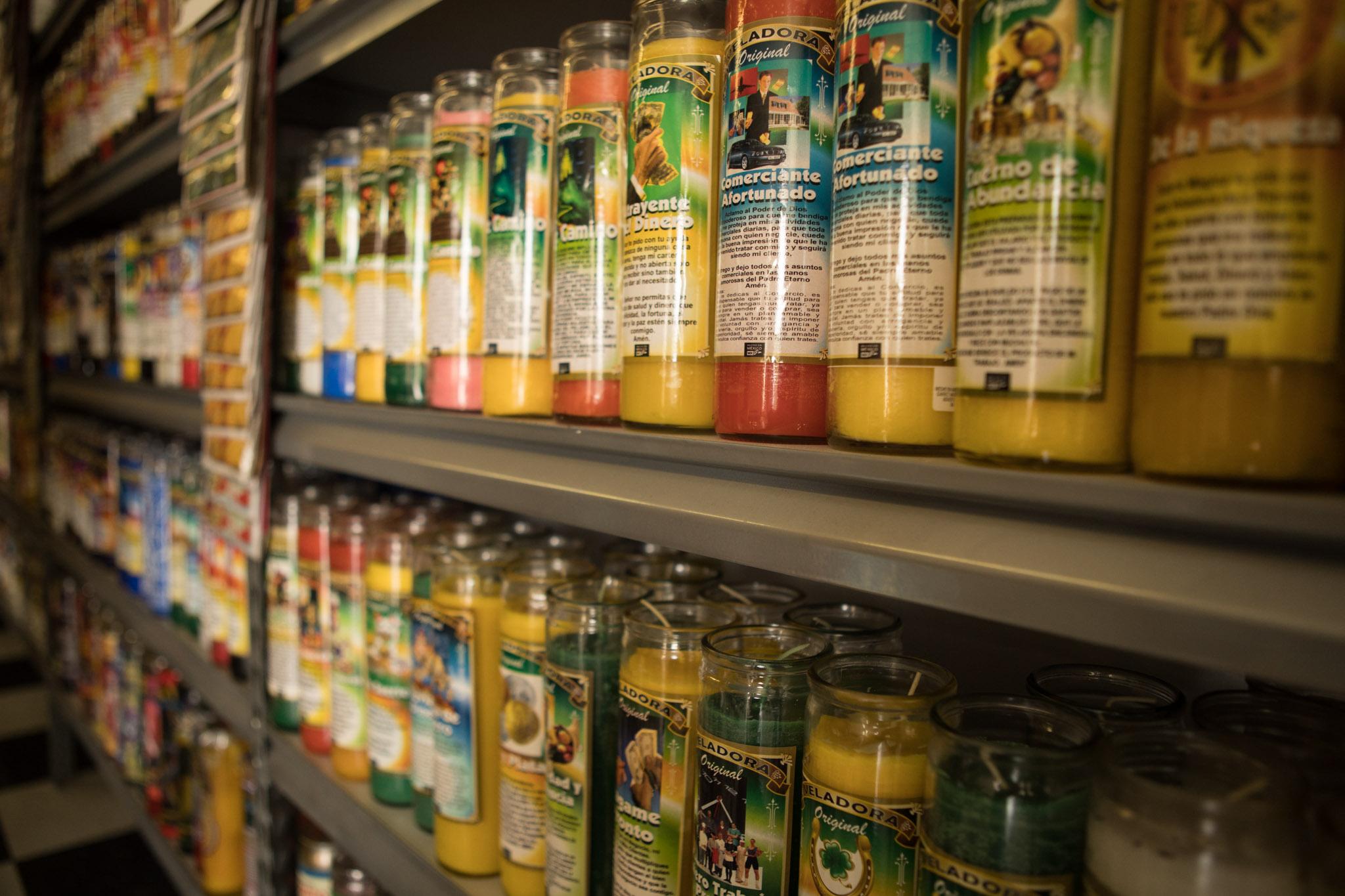 Candles line the shelves of Botanica Obadina.